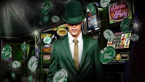 Image of Mr Green wearing a green hat and casino slots at the back